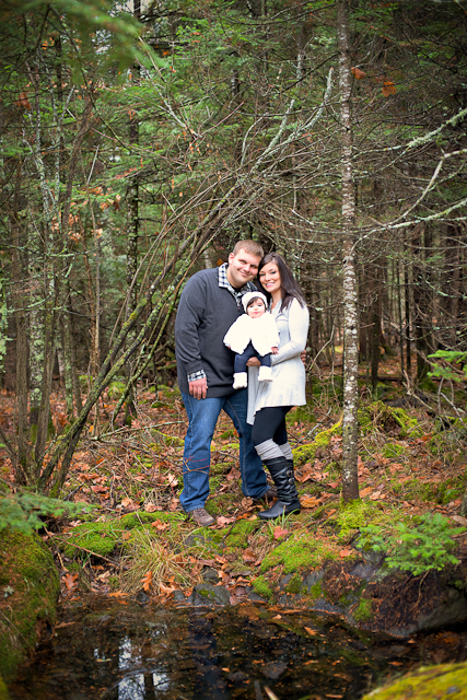 Family photographed in woods near pond